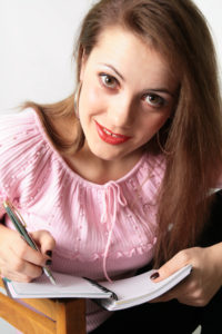 Young woman is writing something and thinking  (See also my other pics)