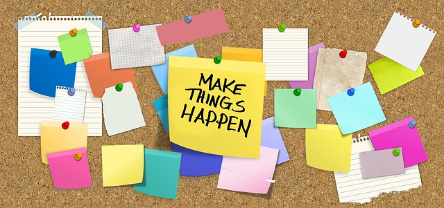 "Bulletin board with a sticky note that says ""Make Things Happen"""