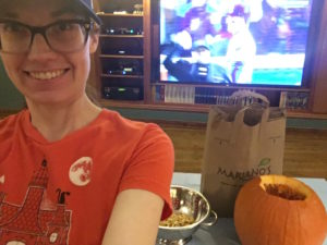 Carving pumpkins during the Cubs game