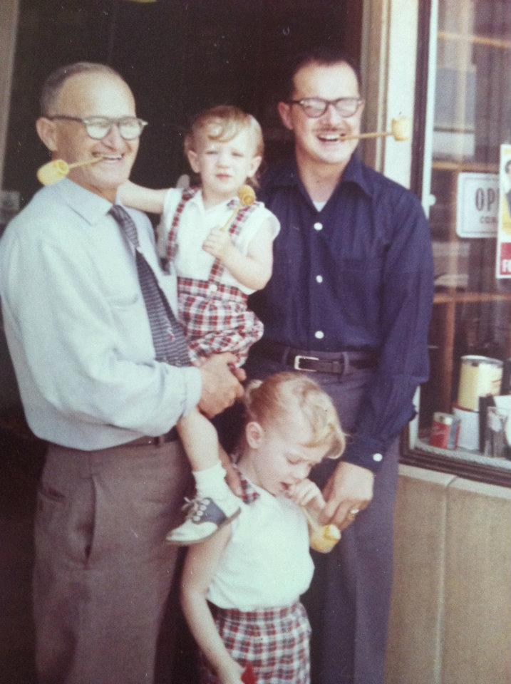 Grandpa Bouett with Rae, Adelle and Vikki outside the family's tobacco shop in downtown Los Angeles, around 1960